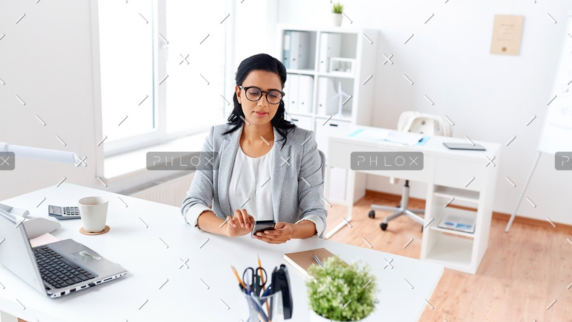 demo-attachment-71-businesswoman-messaging-on-smartphone-at-office-P5AQU8Y